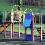 How does playground equipment benefit child development?